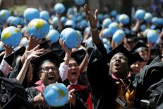 Olufunke Michaels (R) and her classmates celebrate after receiving their degrees from the John F. Kennedy School of Government during the 364th Commencement Exercises at Harvard University in Cambridge, Massachusetts May 28, 2015. REUTERS/Brian Snyder