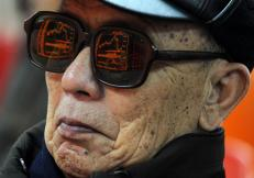 An electronic board showing stock information is reflected on a man's glasses at a brokerage house in Taiyuan, Shanxi province, February 9, 2011. REUTERS/Stringer