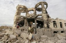 Houthi militants guard the house of Ali Haidar, a Houthi leader, destroyed by a Saudi-led air strike in Sanaa, Yemen, May 29, 2015. A guard was reportedly injured in the strike on the house, whose occupants had already evacuated prior to the strike, according to Houthis guarding the site and local media. REUTERS/Khaled Abdullah