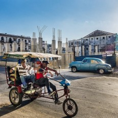 Street scene in Centro Havana where new buildings are being built.