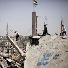 A Palestinian youth practices his Parkour skills in the ruins of buildings in the eastern Gaza City neighbourhood of Shejaiya which was destroyed during the 50-day conflict between Israel and Hamas militants in the summer of 2014. Credit: AFP