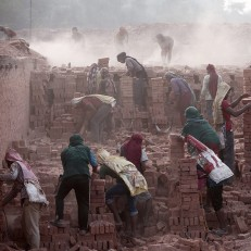 Nepalese labourers work at a brick factory in Bhaktapur, Nepal, May 19th 2015. Nepal is facing an acute brick shortage after hundreds of thousands of houses and 80% of brick kilns were damaged during two major earthquakes on April 25th and May 12th, 2015. The official death toll for both earthquakes has risen to over 8,000. Credit: EPA