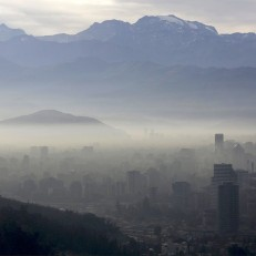 Smog shrouds Chile's capital Santiago on June 22nd 2015. Chilean authorities have declared an environmental emergency for the Santiago metropolitan region forcing more than 900 industries to temporarily shut down and about 40 percent of the capital's 1.7 million cars off the roads. Credit: Reuters