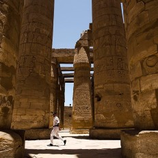 An Egyptian policeman walks through the ruins of Karnak Temple in Luxor, Egypt on June 11th 2015. Militants tried to attack the ancient temple in southern Egypt on June 10th, with a suicide bomber blowing himself up and two gunmen battling police. No sightseers were hurt in the thwarted assault. Credit: AP