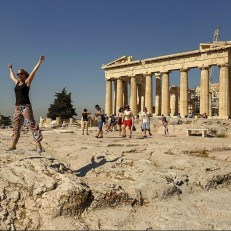 Tourists in front of the Parthenon, an ancient temple on the Acropolis in Athens, June 24th 2015. The Prime Minister of Greece, Alexis Tsipras, has arrived in Brussels for an emergency meeting with the country's creditors in an attempt to thrash out their differences and avoid default on the debt repayment due on June 30th. Credit: AP