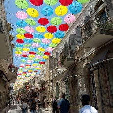 Some 1000 coloured umbrellas decorate a main pedestrian street in Jerusalem on June 30th 2015, as the city's municipality opens more attractions and cultural activities in an effort to bring visitors to the city. Credit: EPA