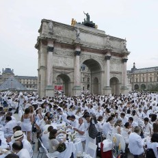 Diners gather at their tables in the Tuileries Gardens near the Louvre Museum during the Diner en Blanc (Dinner in White) in Paris, France, June 11th 2015. Diners dressed head to toe in white gathered together for an impromptu open-air dinner, which takes place at a different place in Paris every year. Participants were told of the venue via social media sites and the internet. Credit: Reuters
