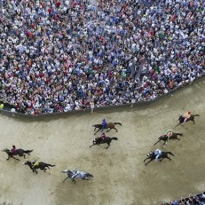 Horses race during the general practice session for the Palio di Siena horse race in Siena, Italy, July 1st 2015. Each July 2nd and August 16th, almost without fail since the mid-1600s, 10 riders have hurtled bareback around Siena's shell-shaped central square in a desperate bid to win the Palio, a silk banner depicting the Madonna and child. Credit: Reuters