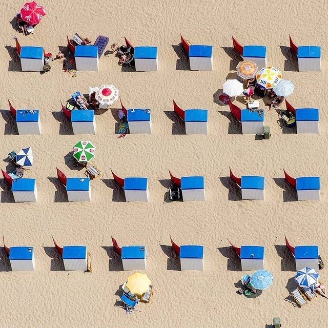 An aerial view of sunbathers on the beach in Noordwijk, The Netherlands, as they enjoy a hot summer day on July 1st 2015. Credit: EPA