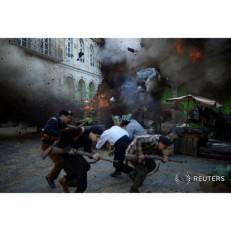 Stuntman Daniel Bargueno Morilla, 26, flies through the air following an explosion during the filming of the Koldo Serra directed feature film Gernika in Guernica, Spain June 17, 2015.