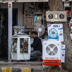 A man repairs an air conditioner at his roadside shop in Ahmedabad, India, May 28th 2015. Many parts of India are reeling under oppressive conditions that have killed hundreds of people. The current heat wave has been particularly deadly due to its high temperatures and long duration. Credit: EPA
