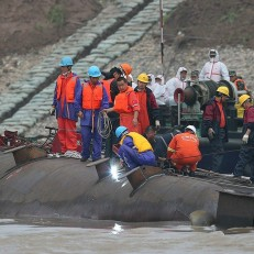 Rescuers cut into the hull of the capsized cruise ship Eastern Star as they search for missing passengers in Jianli, Hubei province, China, June 4th 2015. Hopes of finding people alive are fading as 39 more bodies were pulled from the ship, bringing the confirmed death toll to 65 out of 456 who were on board. Credit: EPA
