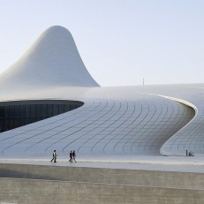 People walk outside the Heydar Aliyev Centre in Baku, Azerbaijan on June 10th 2015, ahead of the 2015 European Games which will run from June 12th to 28th 2015. The Heydar Aliyev Centre is a 619,000 square-foot building designed by British architect Zaha Hadid. Credit: AFP