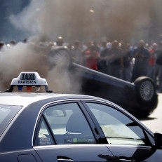 Bad day to be an Uber driver in France. French taxi drivers overturned cars, burned tires in #Paris to protest online cab service UberPOP, citing unfair competition.