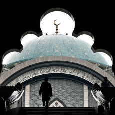 A Malaysian Muslim arrives to offer prayers in Kuala Lumpur on June 19th 2015, the first Friday of the Islamic holy month of Ramadan. During the month tens of millions of people across the world fast from dawn to dusk and strive to be more pious and charitable. The festival of Eid al-Fitr marks the end of Ramadan. Credit: AFP