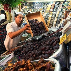 An Indian Muslim arranges dates, an important Ramadan staple, at the Russel market in Bangalore, India, June 17th 2015. Credit: EPA