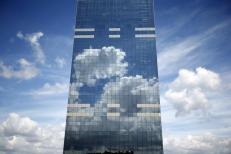 Clouds are reflected in the Midi Tower, the headquarters of the National Pensions Office, in downtown Brussels, Belgium June 21, 2015. REUTERS/Charles Platiau