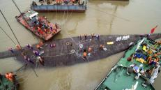 An aerial view shows rescue workers standing on the sunken cruise ship Eastern Star in Jianli, Hubei province, China, June 4, 2015. REUTERS/Stringer