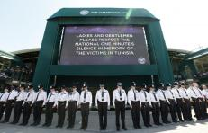Police officers observe a national minute's silence for victim's of the attacks in Tunisia a week ago at the Wimbledon Tennis Championships in London, July 3, 2015. REUTERS/Suzanne Plunkett