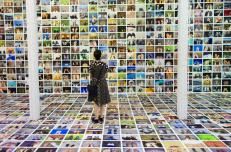 """A woman looks at the installation """"My Feet"""" by Erik Kessels at the F/Stop Photography Festival in Leipzig, Germany June 7, 2014. """"My Feet"""" is a collection of thousands of """"foot selfies"""". REUTERS/Thomas Peter"""
