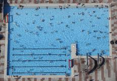 An aerial view shows people cooling off at a swimming pool on a hot summer day in Haltern, Germany, July 1, 2015. REUTERS/Ina Fassbender