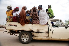 Women travel in a pickup truck in the town of Mararaba after the Nigerian military recaptured it from Boko Haram. REUTERS